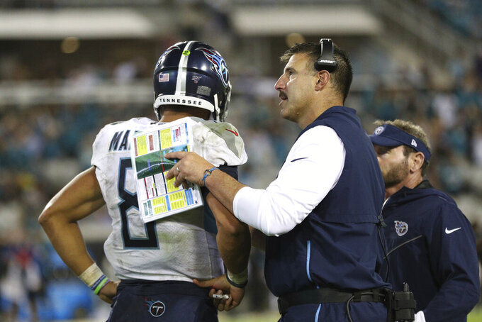 Tennessee Titans quarterback Marcus Mariota (8) gets words of encouragement from head coach Mike Vrabel during an NFL game against the Jacksonville Jaguars, Thursday, Sept. 19, 2019, in Jacksonville, Fla. The Jaguars defeated the Titans 20-7. (Margaret Bowles via AP)