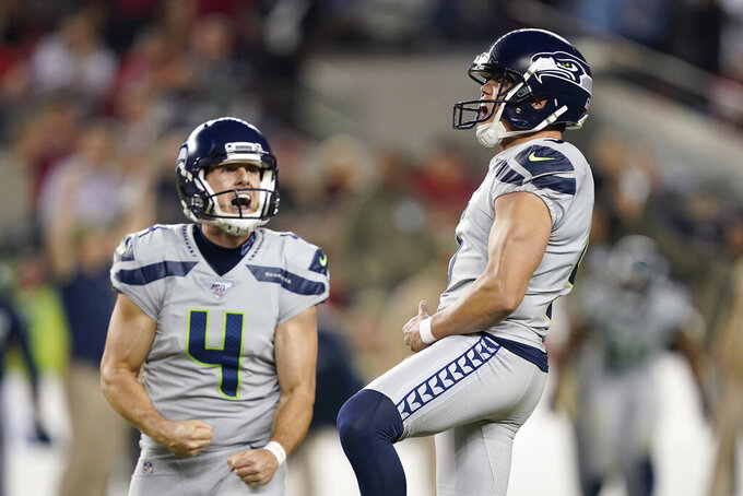 Seattle Seahawks kicker Jason Myers, right, celebrates with Michael Dickson after kicking a field goal against the San Francisco 49ers during the second half of an NFL football game in Santa Clara, Calif., Monday, Nov. 11, 2019. (AP Photo/Tony Avelar)