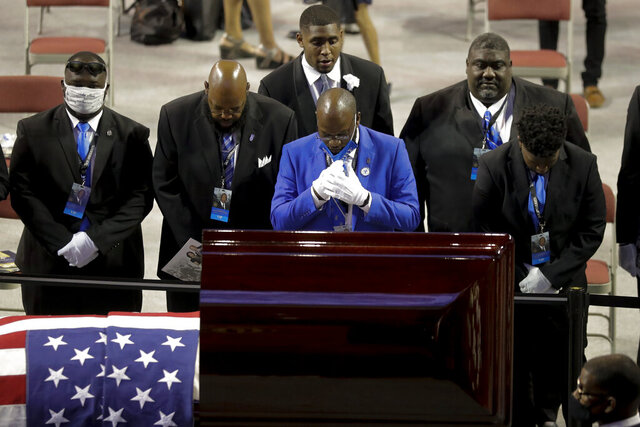 Fraternity members sing in front of the casket of the late Rep. John Lewis, D-Ga., during a service celebrating