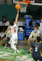 Richmond guard Jacob Gilyard (0) scores after making a steal as Toledo guard Ryan Rollins (5) watches during the first half of an NCAA college basketball game in the first round of the NIT, Wednesday, March 17, 2021, in Denton, Texas. (AP Photo/Ron Jenkins)