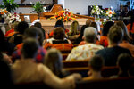 A photo sits next to the casket of Michael Jaramillo, the 11-year-old killed on the Raging River ride at Adventureland, during his funeral at Corinthian Baptist Church Saturday, July 17, 2021 in Des Moines, Iowa. Michael Jaramillo died after an amusement ride capsized. (Brian Powers/The Des Moines Register via AP)