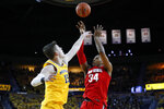 Ohio State forward Kaleb Wesson (34) shoots over Michigan center Jon Teske (15) in the first half of an NCAA college basketball game in Ann Arbor, Mich., Tuesday, Feb. 4, 2020. (AP Photo/Paul Sancya)