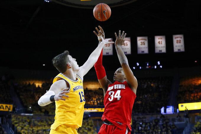 Ohio State forward Kaleb Wesson (34) shoots over Michigan center Jon Teske (15) in the first half of an NCAA college basketball game in Ann Arbor, Mich., Tuesday, Feb. 4, 2020. (AP Photo/Paul Sancya)
