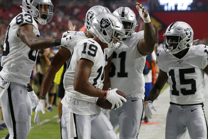 Oakland Raiders wide receiver Ryan Grant (19) celebrates his touchdown against the Arizona Cardinals with wide receiver J.J. Nelson (15), tight end Darren Waller (83) and center Rodney Hudson (61) during the first half of an an NFL football game, Thursday, Aug. 15, 2019, in Glendale, Ariz. (AP Photo/Rick Scuteri)