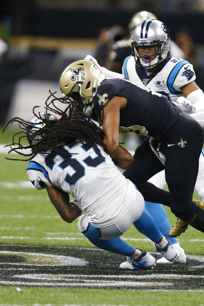 Carolina Panthers free safety Tre Boston (33) intercepts a pass intended for New Orleans Saints wide receiver Tre'Quan Smith (10), during the second half at an NFL football game, Sunday, Nov. 24, 2019, in New Orleans. (AP Photo/Butch Dill)