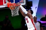 Miami Heat forward Bam Adebayo (13) dunks the ball during the first half of an NBA conference final playoff basketball game against the Boston Celtics on Thursday, Sept. 17, 2020, in Lake Buena Vista, Fla. (AP Photo/Mark J. Terrill)