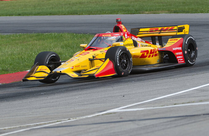 Third-place finisher Ryan Hunter-Reay (28) exits a turn near the end of an IndyCar Series auto race at Mid-Ohio Sports Car Course, Sunday, Sept. 13, 2020, in Lexington, Ohio. (AP Photo/Phil Long)