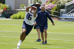 New England Patriots tight end Devin Asiasi (86) makes a catch during NFL football practice in Foxborough, Mass., Thursday, May 27, 2021. (AP Photo/Steven Senne)