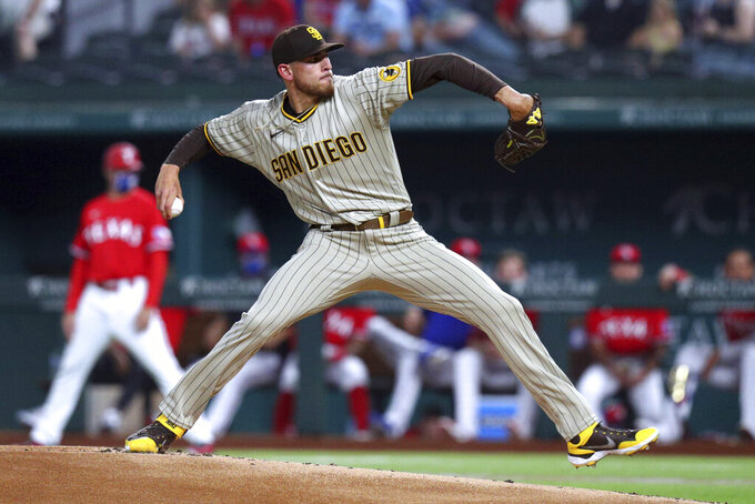 San Diego Padres starting pitcher Joe Musgrove throws to a Texas Rangers batter during the first inning of a baseball game Friday, April 9, 2021, in Arlington, Texas. (AP Photo/Richard W. Rodriguez)