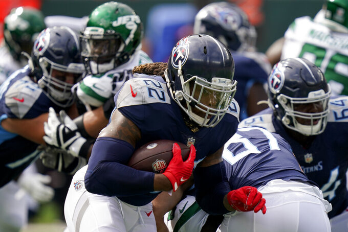 Tennessee Titans running back Derrick Henry (22) runs the ball during the first half of an NFL football game against the New York Jets, Sunday, Oct. 3, 2021, in East Rutherford. (AP Photo/Seth Wenig)