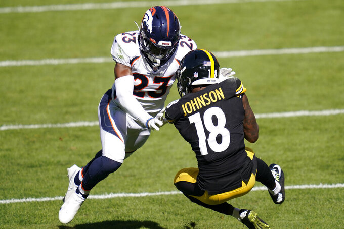 Pittsburgh Steelers wide receiver Diontae Johnson (18) catches a touchdown pass from Ben Roethlsiberger with Denver Broncos cornerback Michael Ojemudia (23) defending during the second half of an NFL football game, Sunday, Sept. 20, 2020, in Pittsburgh. (AP Photo/Keith Srakocic)