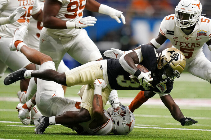 Colorado wide receiver K.D. Nixon (3) is stopped after a catch against Texas during the first half of the Alamo Bowl NCAA college football game Tuesday, Dec. 29, 2020, in San Antonio. (AP Photo/Eric Gay)