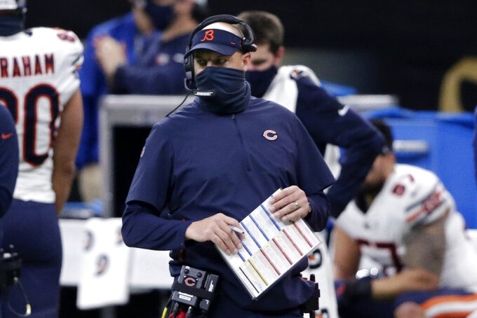 Chicago Bears head coach Matt Nagy walks on the sideline in the first half of an NFL wild-card playoff football game against the New Orleans Saints in New Orleans, Sunday, Jan. 10, 2021. (AP Photo/Butch Dill)