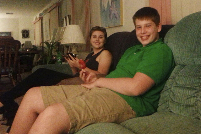 In this July 2016 photo made available by Laurie Giordano, her son Zachary and her daughter Vanessa sit together an an undisclosed location. Zach, a rising junior at a high school in Florida, collapsed while at a football practice in the summer of 2017. He died 11 days later. On Wednesday, April 26, 2020, a Florida legislative committee honored the teenager by renaming a proposed law after him that would put safety measures in place to protect student athletes from deadly heat strokes. (Laurie Giordano via AP)