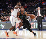 Dallas Mavericks' Dennis Smith Jr. (1) drives past New York Knicks' Tim Hardaway Jr. (3) during the first half of an NBA basketball game Tuesday, March 13, 2018, in New York. (AP Photo/Frank Franklin II)