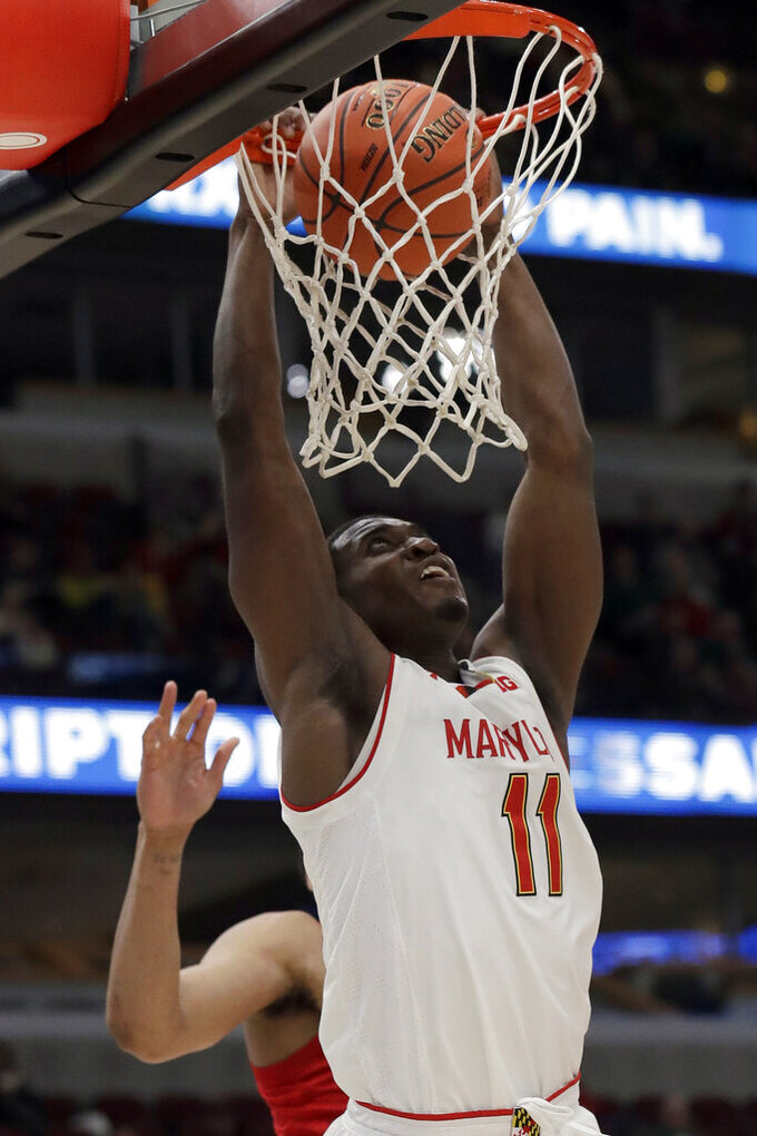 Maryland's Darryl Morsell (11) dunks during the second half of an NCAA college basketball game against the Nebraska in the second round of the Big Ten Conference tournament, Thursday, March 14, 2019, in Chicago. (AP Photo/Nam Y. Huh)