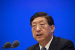 Zeng Yixin, vice minister of China's National Health Commission, speaks during a news conference about China's recent COVID-19 outbreaks and vaccine management plans at the State Council Information Office in Beijing, Saturday, Jan. 9, 2021. COVID vaccine shots will be free in China, where more than 9 million doses have been give to date, health officials in Beijing said Saturday. (AP Photo/Mark Schiefelbein)