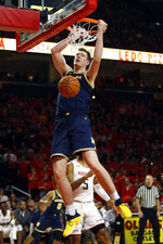 Michigan center Jon Teske dunks against Maryland in the first half of an NCAA college basketball game Sunday, March 3, 2019, in College Park, Md. (AP Photo/Patrick Semansky)