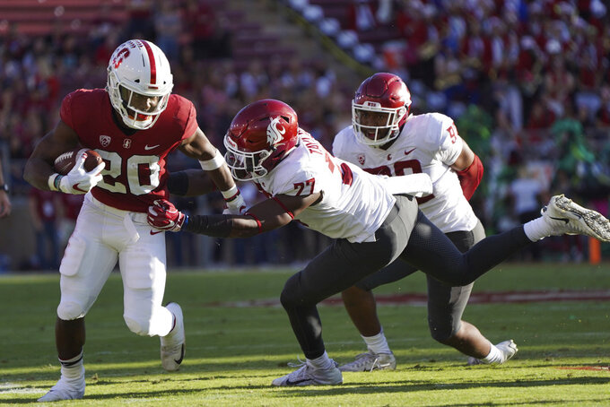 Stanford running back Bryce Love runs downfield in front of Washington St. linebacker Willie Taylor, III, in the first half during an NCAA college football game on Saturday, Oct. 27, 2018, in Stanford, Calif. (AP Photo/Don Feria)