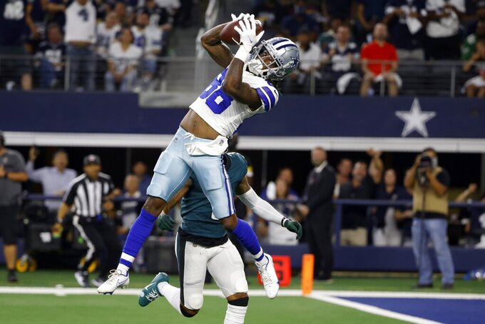 Dallas Cowboys wide receiver CeeDee Lamb (88) catches a long pass in front Philadelphia Eagles cornerback Steven Nelson (3) in the first half of an NFL football game in Arlington, Texas, Monday, Sept. 27, 2021. (AP Photo/Ron Jenkins)