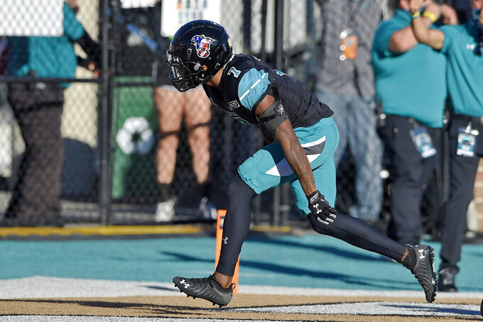 Coastal Carolina's D'Jordan Strong runs an interception back for a touchdown during the second half of an NCAA college football game against Appalachian State, Saturday, Nov. 21, 2020, in Conway, S.C. Coastal Carolina won 34-23. (AP Photo/Richard Shiro)