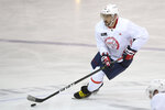 Washington Capitals left wing Alex Ovechkin skates with the puck during practice at the team's NHL hockey training camp, Thursday, Sept. 23, 2021, in Arlington, Va. (AP Photo/Nick Wass)