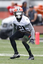 Cleveland Browns cornerback Denzel Ward runs through a drill during NFL football practice at the team's training facility Wednesday, June 2, 2021, in Berea, Ohio. (AP Photo/Ron Schwane)