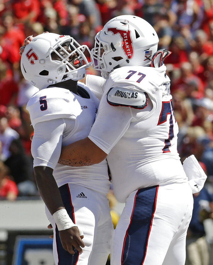 FILE - In this Saturday, Sept. 9, 2017, file photo, Florida Atlantic's Devin Singletary (5) celebrates a touchdown with Roman Fernandez (77) during an NCAA college football game against Wisconsin in Madison, Wis. Oklahoma coach Lincoln Riley believes Singletary will be one of the nation's best running backs this season. (AP Photo/Aaron Gash)