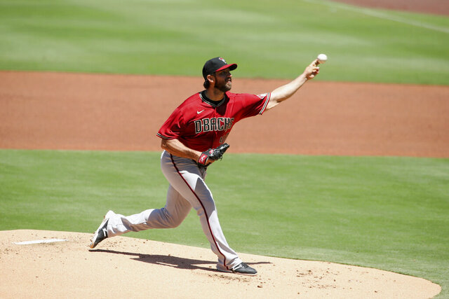 Arizona Diamondbacks starting pitcher Madison Bumgarner throws a pitch against the San Diego Padres in the first inning of a baseball game Sunday, Aug. 9, 2020, in San Diego. (AP Photo/Derrick Tuskan)