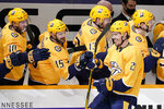 Nashville Predators center Nick Cousins (21) is congratulated after scoring a goal against the Chicago Blackhawks in the third period of an NHL hockey game Wednesday, Jan. 27, 2021, in Nashville, Tenn. (AP Photo/Mark Humphrey)