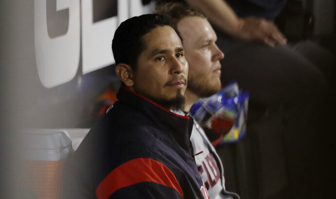 FILE - In this May 30, 2019 file photo, Cleveland Indians starting pitcher Carlos Carrasco looks to the field from the dugout during the seventh inning of a baseball game against the Chicago White Sox in Chicago. Carrasco is being treated for leukemia. He made the revelation to a TV station in the Dominican Republic, where he was visiting a hospital. Carrasco, who was diagnosed in June, 2019 remains positive about his prognosis and believes he will pitch again this season. (AP Photo/Nam Y. Huh, File)