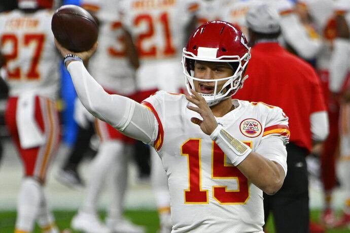 Kansas City Chiefs quarterback Patrick Mahomes (15) warms up before an NFL football game against the Las Vegas Raiders, Sunday, Nov. 22, 2020, in Las Vegas. (AP Photo/David Becker)