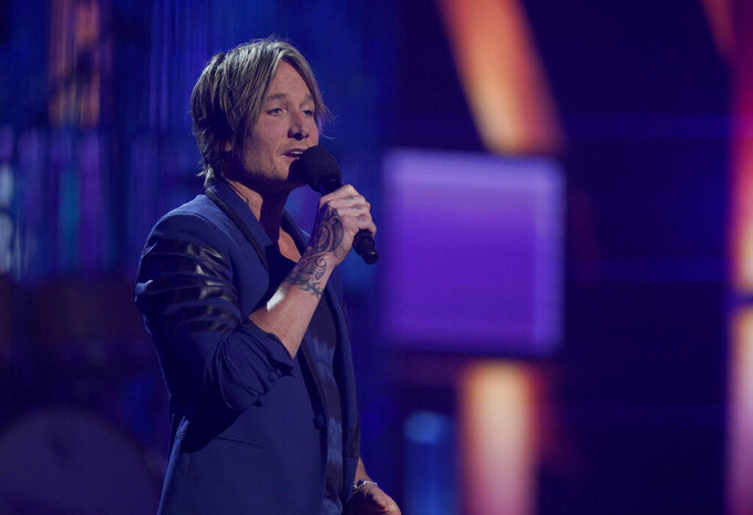 Host Keith Urban speaks at the 56th annual Academy of Country Music Awards on Sunday, April 18, 2021, at the Grand Ole Opry in Nashville, Tenn. (AP Photo/Mark Humphrey)