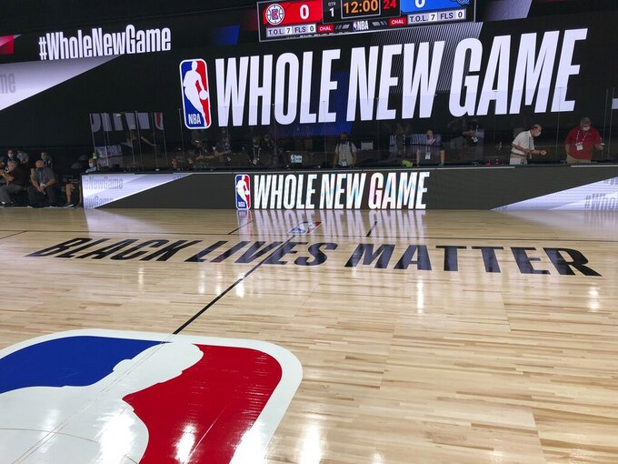 """A basketball court is shown at the ESPN Wide World of Sports complex in Kissimmee, Fla., Tuesday, July 21, 2020. The NBA's marketing motto for the restart of the season at Walt Disney World is """"Whole New Game,"""" and in many respects, that's very true. (AP Photo/Tim Reynolds)"""
