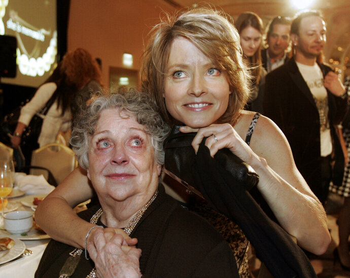 """FILE - This Dec. 4, 2007 file photo shows actress-director Jodie Foster, right, with her mother Evelyn Foster after she received the Sherry Lansing Leadership Award at during the 16th annual Women in Entertainment breakfast in Beverly Hills, Calif. Evelyn """"Brandy"""" Foster, who managed her daughter Jodie's career from her child-prodigy years through two Academy Awards, died peacefully at her Los Angeles home of complications from dementia, Monday, May 13, 2019. She was 90. (AP Photo/Kevork Djansezian, File)"""