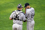 Chicago White Sox pitcher Dylan Cease (84) and catcher Yasmani Grandal talk on the mound in the third inning of a baseball game against the Minnesota Twins, Monday, July 5, 2021, in Minneapolis. (AP Photo/Jim Mone)