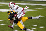 Iowa wide receiver Ihmir Smith-Marsette is tackled by Wisconsin cornerback Faion Hicks (1) after catching a pass during the second half of an NCAA college football game, Saturday, Dec. 12, 2020, in Iowa City, Iowa. Iowa won 28-7. (AP Photo/Charlie Neibergall)