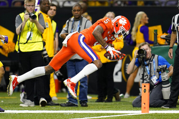 FILE - In this Jan. 13, 2020, file photo, Clemson wide receiver Tee Higgins scores against LSU during the first half of an NCAA College Football Playoff national championship game in New Orleans. This year's NFL draft features a superb group of wide receivers, including Higgins, who are expected to make immediate impacts in the NFL. (AP Photo/David J. Phillip, File)