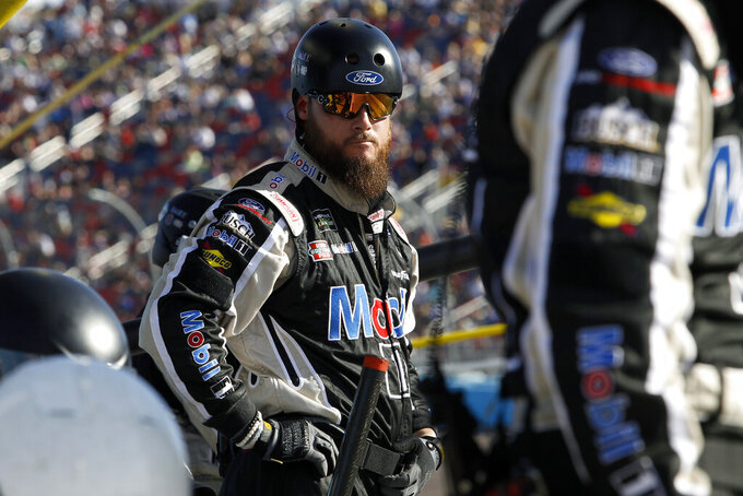 Pit crew member for driver Kevin Harvick during the NASCAR Cup Series auto race at ISM Raceway, Sunday, Nov. 10, 2019, in Avondale, Ariz. (AP Photo/Ralph Freso)