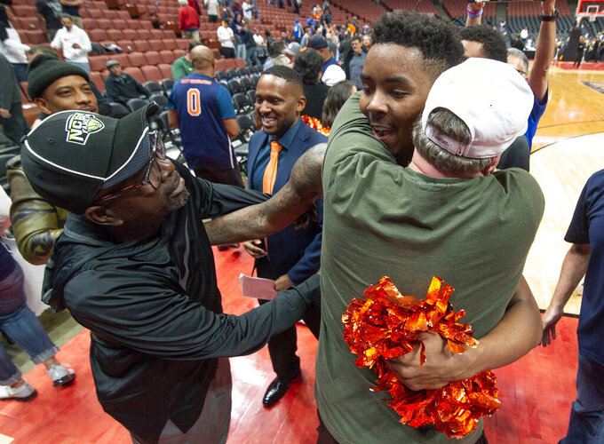 Cal State Fullerton guard Khalil Ahmad is being congratulated by the fans after defeating UC Santa Barbara in an NCAA college basketball game at the Big West men's tournament in Anaheim, Calif., Friday, March 15, 2019. (AP Photo/Kyusung Gong)
