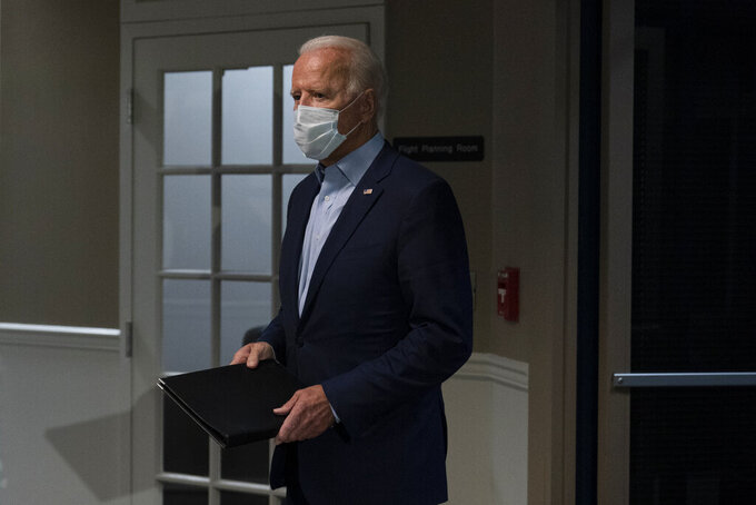 Democratic presidential candidate former Vice President Joe Biden arrives to speak about the death of Supreme Court Justice Ruth Bader Ginsburg after he arrives at at New Castle Airport, in New Castle, Del., Friday, Sept. 18, 2020, as he returns from Duluth, Minn. (AP Photo/Carolyn Kaster)