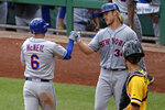 New York Mets' Jeff McNeil (6) is greeted by starting pitcher Noah Syndergaard (34) who was on base for his two-run home run off Pittsburgh Pirates relief pitcher Yefry Ramirez during the seventh inning of a baseball game in Pittsburgh, Sunday, Aug. 4, 2019. The Mets won 13-2. (AP Photo/Gene J. Puskar)