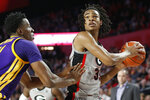 Georgia forward Nicolas Claxton (33) looks to shoot while being defended by LSU forward Kavell Bigby-Williams (11) during an NCAA college basketball game in Athens, Ga., Saturday, Feb. 16, 2019. (Joshua L. Jones/Athens Banner-Herald via AP)