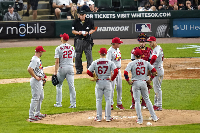 St. Louis Cardinals starting pitcher Jack Flaherty (22) walks to the dugout after being pulled from an interleague baseball game by manager Mike Shildt in the fourth inning against the Chicago White Sox Tuesday, May 25, 2021, in Chicago. (AP Photo/Charles Rex Arbogast)