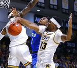 Virginia Commonwealth's Isaac Vann (13) and Corey Douglas combine to shut down Florida Gulf Coast's Zach Scott during an NCAA college basketball game at Virginia Commonwealth University's Siegel Center in Richmond, Va., Saturday, Nov. 23, 2019. (Joe Mahoney/Richmond Times-Dispatch via AP)