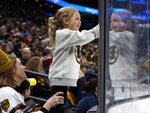 Four-year-old Kate Sterio, of Marblehead, Mass., smiles as she watches during the first period of an NHL hockey game between the Boston Bruins and the Los Angeles Kings, Saturday, Feb. 9, 2019, in Boston. (AP Photo/Winslow Townson)