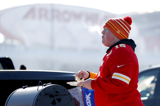 A fan tailgates outside Arrowhead Stadium before the NFL AFC Championship football game between the Kansas City Chiefs and the Tennessee Titans Sunday, Jan. 19, 2020, in Kansas City, MO. (AP Photo/Jeff Roberson)