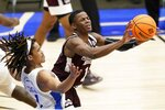 Saint Louis guard Yuri Collins, left, defends in the paint as Mississippi State guard Iverson Molinar (1) makes a pass during the second half of an NCAA college basketball game in the first round of the NIT Tournament, Saturday, March 20, 2021, in Frisco, Texas. (AP Photo/Tony Gutierrez)