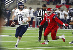 Nevada quarterback Carson Strong rolls out of the pocket as Fresno State defensive tackle Kevin Atkins gives chase during the first half of an NCAA college football game in Fresno, Calif., Saturday, Nov. 23, 2019. (AP Photo/Gary Kazanjian)