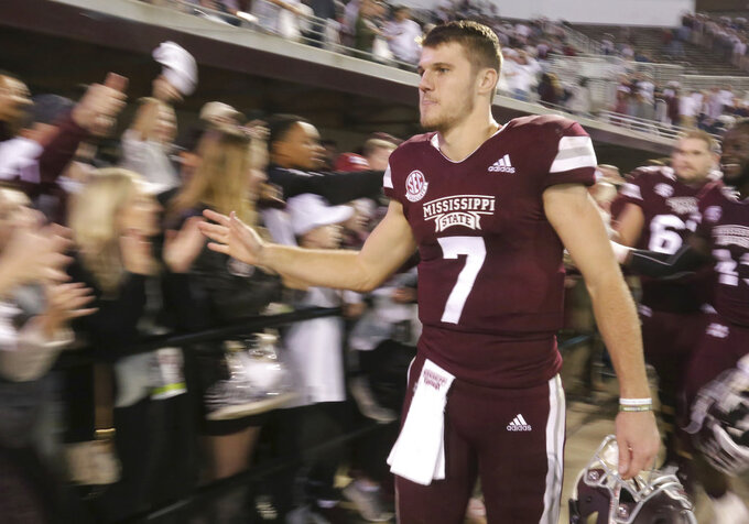 Unidentified Mississippi State fans line up after their NCAA college football game to congratulate Mississippi State quarterback Nick Fitzgerald (7) on the 28-13 win over Texas A&M on Saturday, Oct. 27, 2018, in Starkville, Miss. (AP Photo/Jim Lytle)